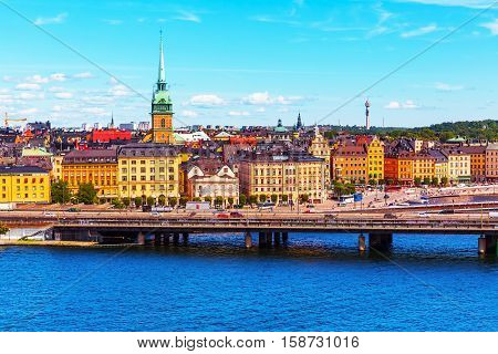 Scenic summer panorama of the Old Town (Gamla Stan) architecture pier in Stockholm, Sweden
