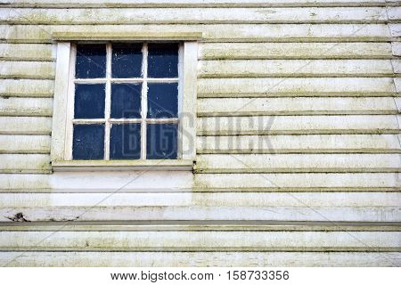 Old wooden sash window and weather boarding