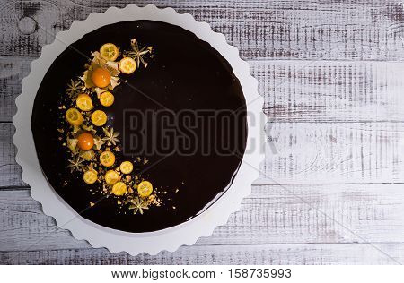 chocolate color drip cream cheese with anise and kumquat-