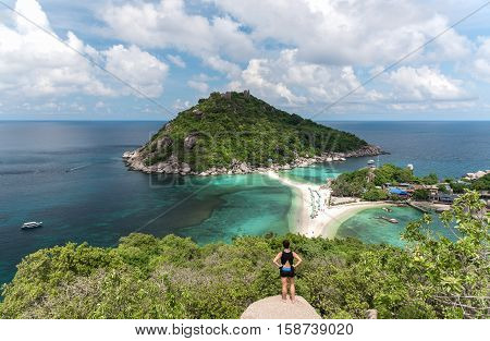Woman standing at the view point of Nang yuan island. Thailand