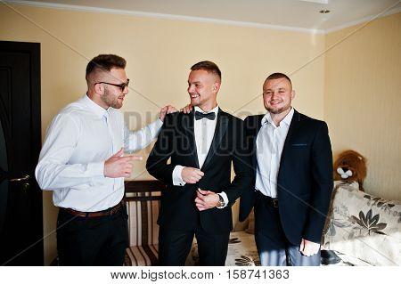 Three Handsome Male Friends Meet And Speeking Each Other. Groomsman Or Best Man Greeting Groom At We