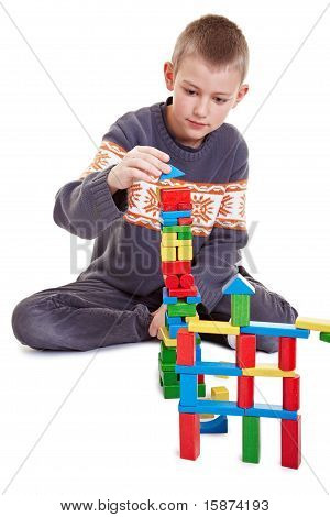 Child Building A Tower
