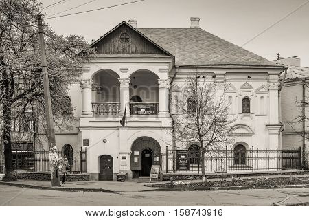 Kyiv Ukraine - November 26 2016: Facade of an ancient building. The house of Peter the Great located in Podil district of Kyiv Ukraine. Black and white photography sepia toned.