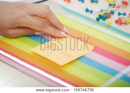 Human hand holding adhesive note with You can text