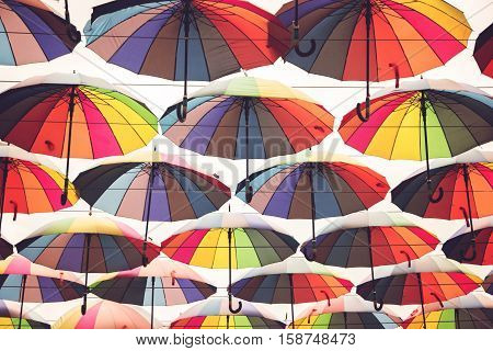 Multi colored umbrellas. Umbrellas with white background. Palette of happiness. Hide yourself from the rain.