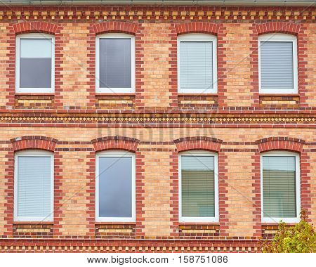 Germany, windows on brick wall house facade pattern