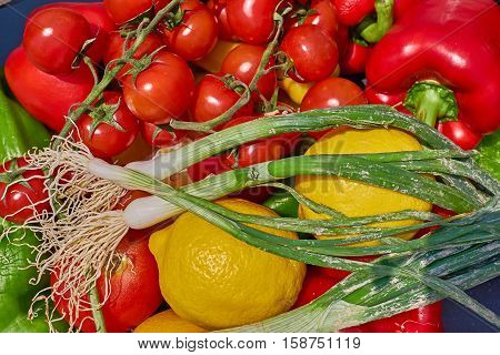 variety of organic fresh vegetables closeup colorful background