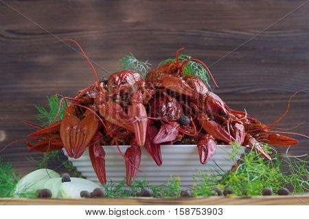 Red Boiled Crayfishes, Fennel, Onions, Peppers On Wooden Background