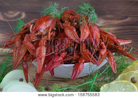 Red Boiled Crayfishes, Fennel, Onions, Lemon On Wooden Background