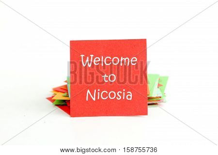 picture of a red note paper with text welcome to nicosia