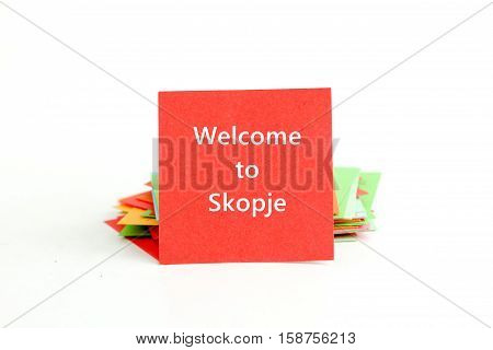 picture of a red note paper with text welcome to skopje