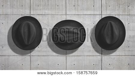 Top view of a classic black felt fedora hat shot as a mockup set on neutral gray concrete industrial background