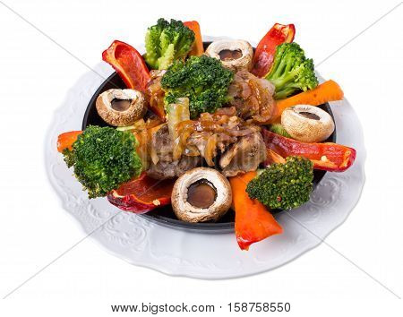 Grilled pork shish kebab with delicious broccoli and mushrooms. Isolated on a white background.