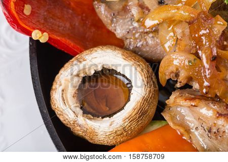 Closeup of grilled champignon as a garnish for pork shish kebab. MAaro. Photo can be used as a whole background.