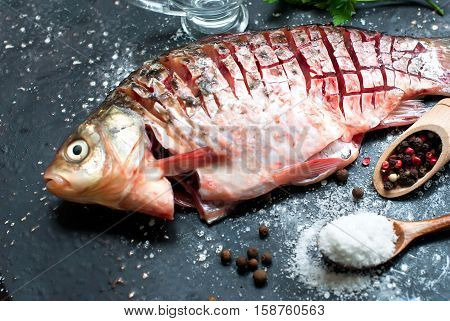 Raw Fish With Lemon, Herbs And Spices On Dark Vintage Background, Top View