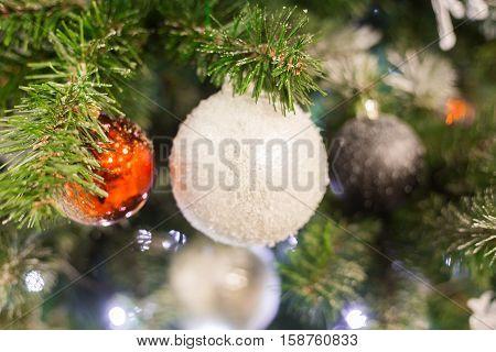Christmas tree and Christmas decorations. White Christmas ball