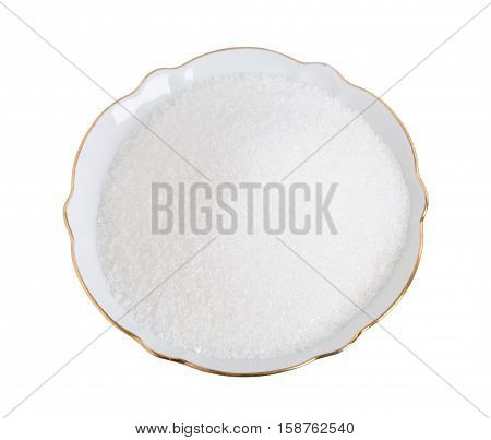 Closeup of sugar in white bowl. Isolated on a white background.