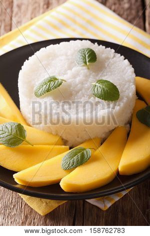Glutinous Rice With Ripe Mango Close-up Te On The Table. Vertical