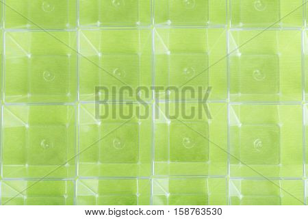Closeup of baking plastic forms on green tablecloth. Photo can be used as a whole background.