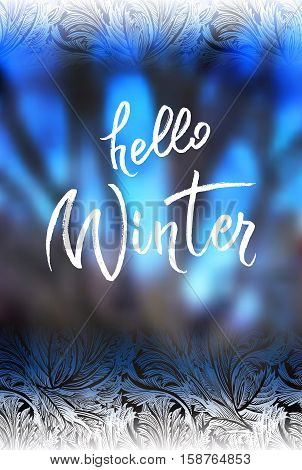 Hello winter brush lettering calligraphy at blue blur winter background with frost hoar border frame. Frozen glass design. Vector illustration stock vector.