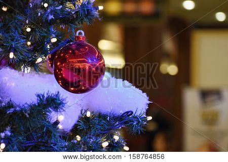 Colorful Christmas Decoration. Winter Holidays And Traditional Ornaments On A Christmas Tree. Lighti