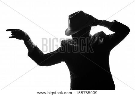 Silhouette of a private detective with a gun in right hand. Gangster looks like mafiosi and stay side to camera. He wears a mob jacket. Police criminal scene in black and white. Studio shot isolated or cutout from background.