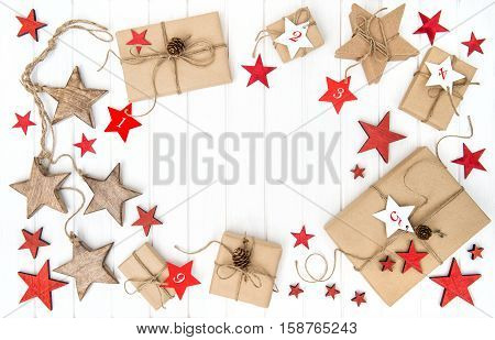 Wrapped gifts Advent calendar Christmas decoration red stars. Flat lay