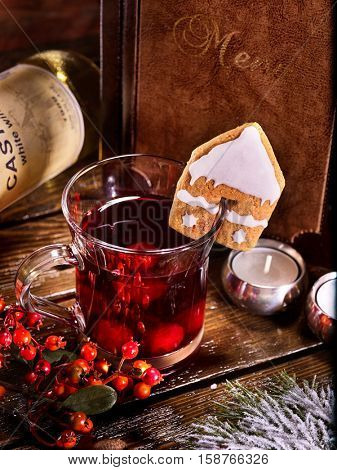 Hot alcohol punch with menu card. Ginger snap in form of house decorated punch mug. Menu card background.