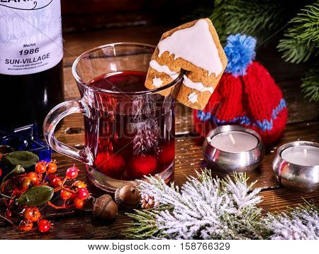 Winter hot drink. Hot mulled wine with cookie. Winter house and hat simbol winter.