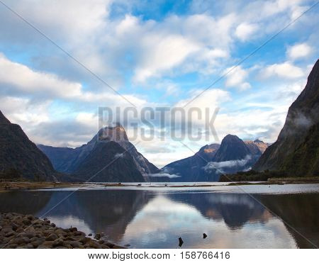 reflection of high mountain glacier at milford sound Fiordland New Zealand