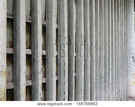 Old wall of wooden bars. Background from old boards.