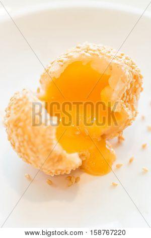 Chinese dim sum Fried sesame balls stuff with custard lava - Chinese groumet cuisine