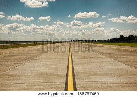 Empty runway in the airport on a sunny summer day