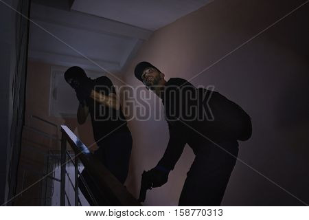 Male thieves on stairs