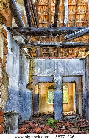 destroyed old house room ruins. Indoor view