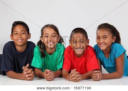 Smiling school kids on floor
