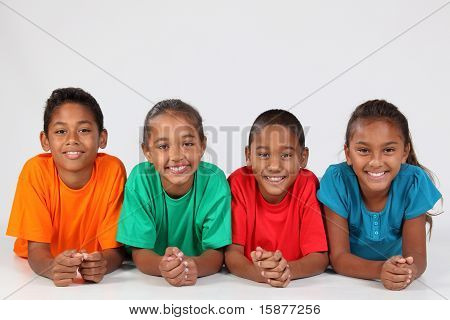 Four young friends lying on floor