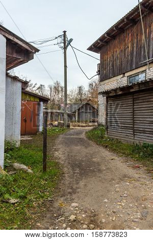 The back streets of a provincial town. The path on which people shorten the way between two streets of a provincial town.