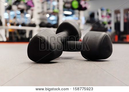 Two Of Dumbbells In Sport Club Or Gym And Fitness Room.