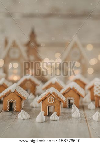 against the background of a burning garland gingerbread houses and meringue