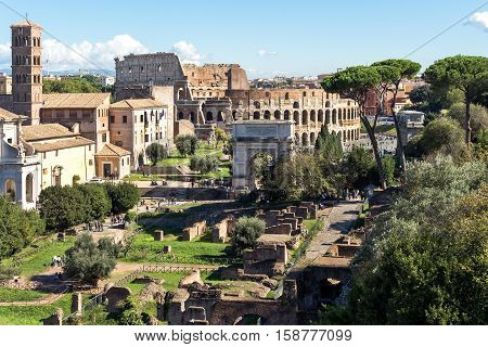 Ruins of the colosseum and arch of constantine in Rome, Italy