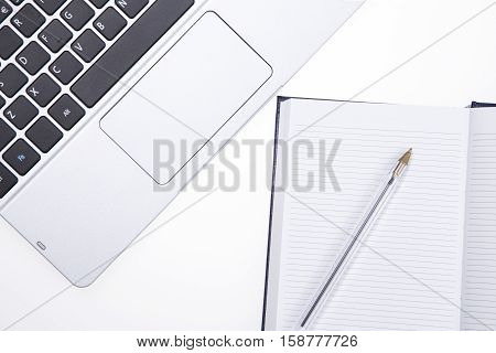 Laptop And Note Pad With Pen
