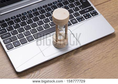 Egg Timer On An Open Laptop Keyboard