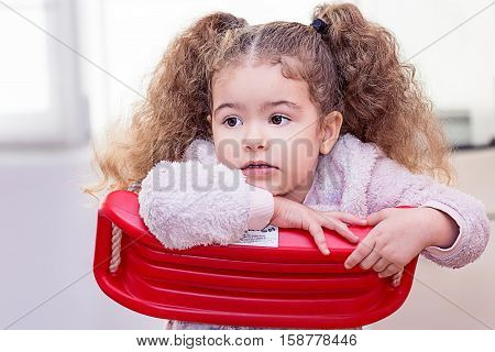 Beautiful toddler girl curly blond cool hair 3 years old