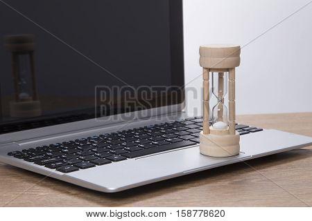 Sand Running Through An Egg Timer On A Laptop Computer