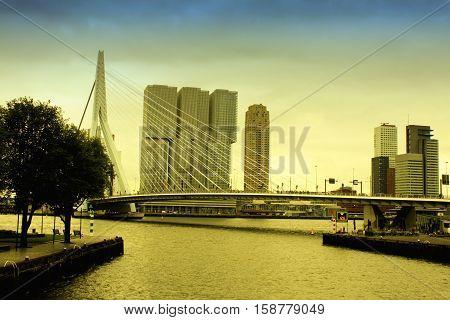 Vintage scene of amasing Erasmus Bridge and architecture in Rotterdam city, the Nederlands.