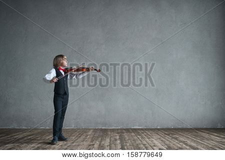 Little boy playing a violin