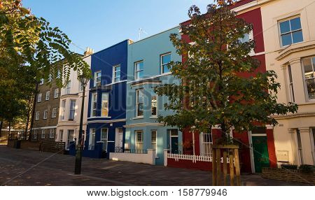 The multicolored Notting Hill houses in Portobello road market London United Kingdom.