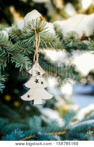 Christmas background with fir tree wooden closeup
