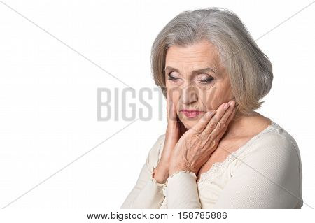 Portrait of thoughtful senior woman isolated on white background